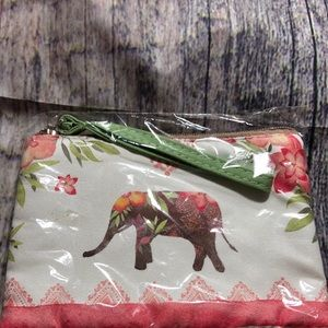 Nylon wristlet with lucky elephant print on front.